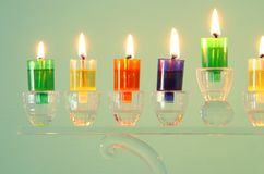 Image of jewish holiday Hanukkah background with crystal menorah & x28;traditional candelabra& x29; and colorful oil candles. Image of jewish holiday Hanukkah royalty free stock images