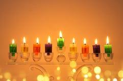 Image of jewish holiday Hanukkah background with crystal menorah & x28;traditional candelabra& x29; and colorful oil candles. Image of jewish holiday Hanukkah stock photo