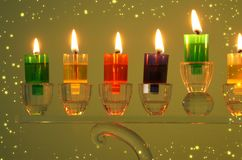 Image of jewish holiday Hanukkah background with crystal menorah & x28;traditional candelabra& x29; and colorful oil candles. Image of jewish holiday Hanukkah stock photos