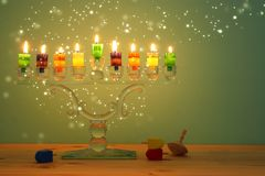 Image of jewish holiday Hanukkah background with crystal menorah & x28;traditional candelabra& x29; and colorful oil candles. Image of jewish holiday Hanukkah royalty free stock image