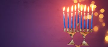 Image of jewish holiday Hanukkah background with menorah & x28;traditional candelabra& x29; and burning candles. Image of jewish holiday Hanukkah Royalty Free Stock Images