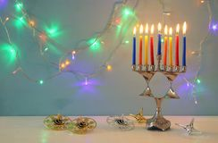 image of jewish holiday Hanukkah background with menorah & x28;traditional candelabra& x29; and burning candles Stock Photo