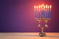 image of jewish holiday Hanukkah background with menorah & x28;traditional candelabra& x29; and burning candles. Royalty Free Stock Images