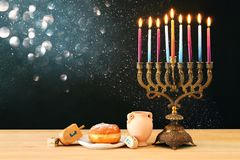 Image of jewish holiday Hanukkah background with menorah & x28;traditional candelabra& x29; and burning candles. Image of jewish holiday Hanukkah background stock photos