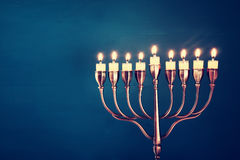 Image of jewish holiday Hanukkah background. With menorah (traditional candelabra) and burning candles