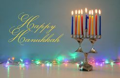 Image of jewish holiday Hanukkah background with menorah & x28;traditional candelabra& x29; and burning candles. Image of jewish holiday Hanukkah background