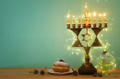 Image of jewish holiday Hanukkah background with menorah & x28;traditional candelabra& x29; and burning candles. Image of jewish holiday Hanukkah background stock photo