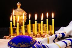 Jewish holiday Hanukkah background with menorah traditional candelabra and burning candles Royalty Free Stock Images