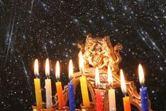 Image of jewish holiday Hanukkah background with menorah (traditional candelabra) Burning candles over black background Royalty Free Stock Image