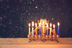 Image of jewish holiday Hanukkah background with menorah (traditional candelabra) Burning candles over black background Royalty Free Stock Photography
