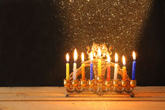 Image of jewish holiday Hanukkah background with menorah (traditional candelabra) Burning candles over black background Stock Photos