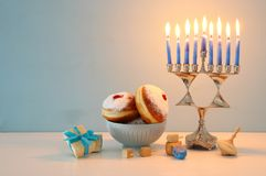 Image of Jewish holiday Hanukkah background with menorah & x28;traditional candelabra& x29; and candles. Stock Photos