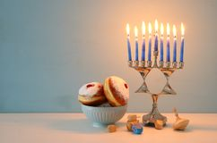 Image of jewish holiday Hanukkah background with menorah & x28;traditional candelabra& x29; and candles. Image of jewish holiday Hanukkah background with stock image
