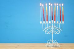 Image of jewish holiday Hanukkah background with menorah & x28;traditional candelabra& x29; and colorful candles. Image of jewish holiday Hanukkah background royalty free stock photo