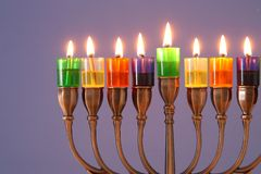 Image of jewish holiday Hanukkah background with menorah & x28;traditional candelabra& x29; and colorful oil candles. Image of jewish holiday Hanukkah royalty free stock photography