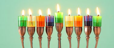 Image of jewish holiday Hanukkah background with menorah & x28;traditional candelabra& x29; and colorful oil candles. Image of jewish holiday Hanukkah royalty free stock photos