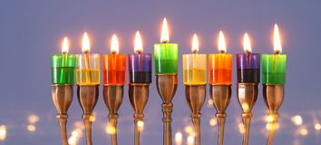 image of jewish holiday Hanukkah background with menorah & x28;traditional candelabra& x29; and colorful oil candles. royalty free stock image