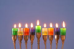 Image of jewish holiday Hanukkah background with menorah & x28;traditional candelabra& x29; and colorful oil candles. Image of jewish holiday Hanukkah royalty free stock images