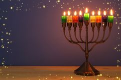 Image of jewish holiday Hanukkah background with menorah & x28;traditional candelabra& x29; and colorful oil candles. Image of jewish holiday Hanukkah stock images