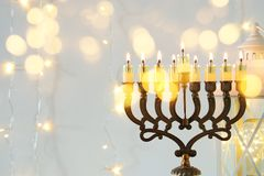 Image of jewish holiday Hanukkah background with menorah & x28;traditional candelabra& x29;. And burning candles Royalty Free Stock Image