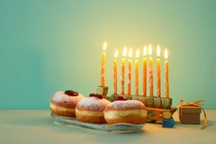Image of jewish holiday Hanukkah background with menorah & x28;traditional candelabra& x29;. Selective focus. Image of jewish holiday Hanukkah background with stock photos