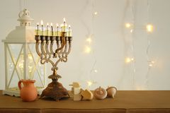 Image of jewish holiday Hanukkah background with traditional spinnig top, menorah & x28;traditional candelabra& x29;. And burning candles royalty free stock images