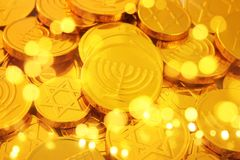Image of jewish holiday Hanukkah gold chocolate coins. Image of jewish holiday Hanukkah with wooden dreidels colection & x28;spinning top& x29; and gold Stock Photography