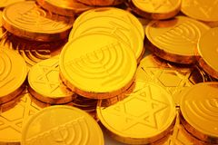 Image of jewish holiday Hanukkah gold chocolate coins. Image of jewish holiday Hanukkah with wooden dreidels colection & x28;spinning top& x29; and gold Stock Photos