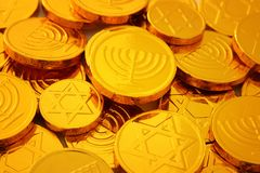 Image of jewish holiday Hanukkah gold chocolate coins. Image of jewish holiday Hanukkah with wooden dreidels colection & x28;spinning top& x29; and gold Royalty Free Stock Images