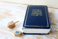 Image of Jewish holiday Hanukkah. Hebrew Bible Tanakh Torah, Neviim, Ketuvim and Wooden dreidels toys Hanukkah, holiday symbols royalty free stock photography