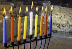 Image of jewish holiday Hanukkah with menorah (traditional candelabra) and burning candles on Jerusalem background. royalty free stock photo