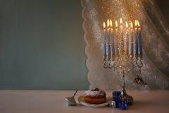 Image of jewish holiday Hanukkah with menorah Stock Photo