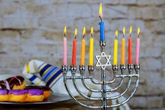 Image of jewish holiday Hanukkah with menorah traditional Candelabra , donuts. Selective focus image of jewish holiday Hanukkah with menorah traditional royalty free stock images