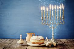Image of jewish holiday Hanukkah with wooden dreidels. Image of jewish holiday Hanukkah with menorah & x28;traditional Candelabra& x29 royalty free stock photo