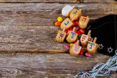 Image of jewish holiday Hanukkah with wooden dreidel. Spinning top on the glitter background Stock Images