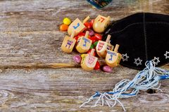 Image of jewish holiday Hanukkah with wooden dreidel spinning top on the glitter background. Jewish holiday, Holiday symbol Hanukkah Image of jewish holiday Stock Photography