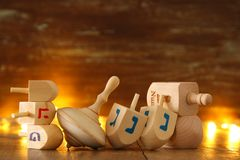Image of jewish holiday Hanukkah with wooden dreidels colection & x28;spinning top& x29; and glowing gold lights. Image of jewish holiday Hanukkah with Stock Photography