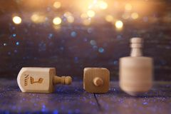 Image of jewish holiday Hanukkah with wooden dreidels colection & x28;spinning top& x29; and glowing gold lights. Image of jewish holiday Hanukkah with Stock Image