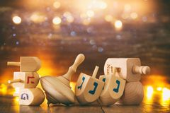 Image of jewish holiday Hanukkah with wooden dreidels colection & x28;spinning top& x29; and glowing gold lights. Image of jewish holiday Hanukkah with Royalty Free Stock Image
