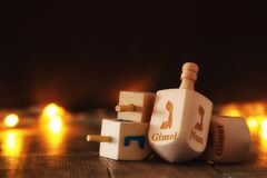 Image of jewish holiday Hanukkah with wooden dreidels colection & x28;spinning top& x29; and glowing gold lights. Image of jewish holiday Hanukkah with Royalty Free Stock Photography