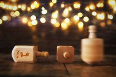 Image of jewish holiday Hanukkah with wooden dreidels colection & x28;spinning top& x29; and glowing gold lights stock photography