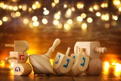 Image of jewish holiday Hanukkah with wooden dreidels colection & x28;spinning top& x29; and glowing gold lights. Image of jewish holiday Hanukkah with Royalty Free Stock Photos