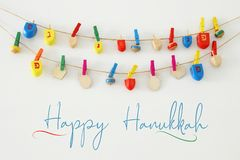 Image of jewish holiday Hanukkah with wooden dreidels colection & x28;spinning top& x29; over white background. Image of jewish holiday Hanukkah with wooden stock photography