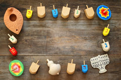 Image of jewish holiday Hanukkah with wooden dreidels Stock Images