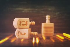 Image of jewish holiday Hanukkah with wooden dreidels colection & x28;spinning top& x29; and glowing gold lights Royalty Free Stock Photo