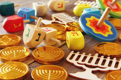 Image of jewish holiday Hanukkah with wooden dreidels Royalty Free Stock Photos