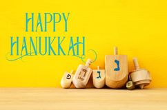 Image of jewish holiday Hanukkah with wooden dreidels & x28;spinning royalty free stock photos