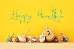 Image of jewish holiday Hanukkah with wooden dreidels & x28;spinning top. Image of jewish holiday Hanukkah with wooden dreidels & x28;spinning top stock image