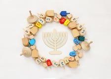 Image of jewish holiday Hanukkah with wooden dreidels Royalty Free Stock Image