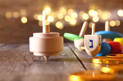 Image of jewish holiday Hanukkah with wooden dreidels Stock Image
